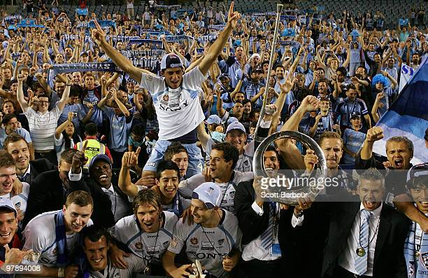 Sydney FC players pose for a team shot with Sydney fans after winning the ALeague Grand Final match between the Melbourne Victory and Sydney FC at...