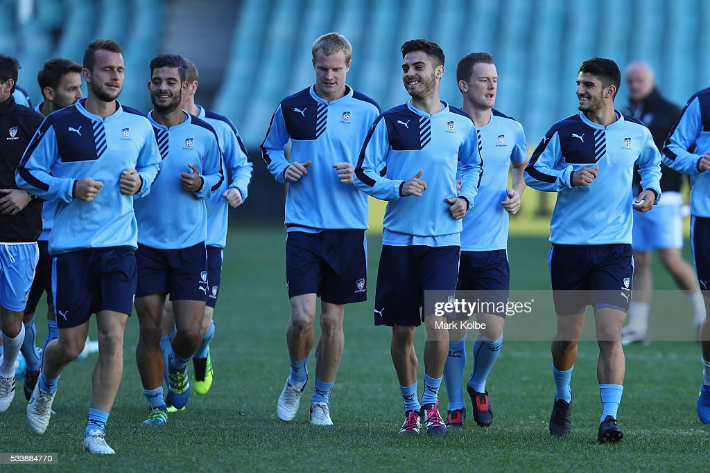 Sydney Fc players runs as they warm up during a Sydney FC training session at Allianz Stadium on May 24, 2016 in Sydney, Australia.