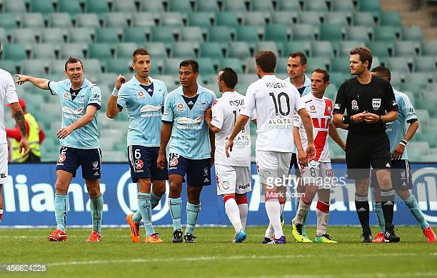 Sydney FC players taunt Harry Kewell after he missed a penalty shot at goal during the round 10 ALeague match between Sydney FC and the Melbourne...