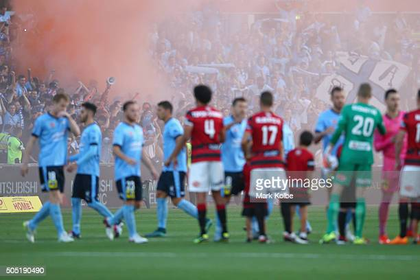 Sydney FC supporters set off a flare before play during the round 15 ALeague match between the Western Sydney Wanderers and Sydney United at Pirtek...