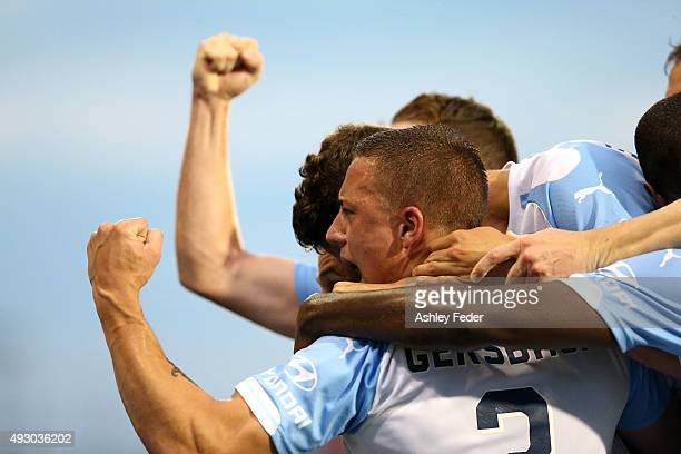 Sydney FC team mates celebrate a goal during the round two ALeague match between the Newcastle Jets and Sydney FC at Hunter Stadium on October 17...
