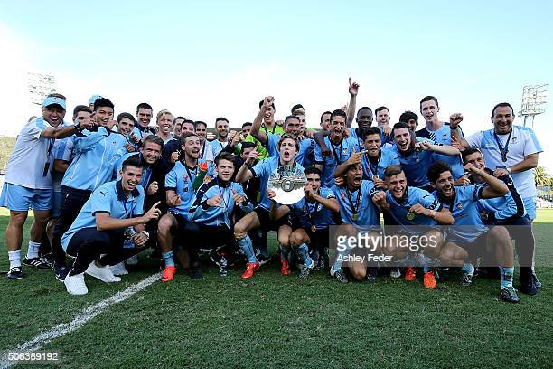 Sydney FC team mates celebrate the win with the trophy during the National Youth League Final match between Adelaide United and Sydney FC at Central...