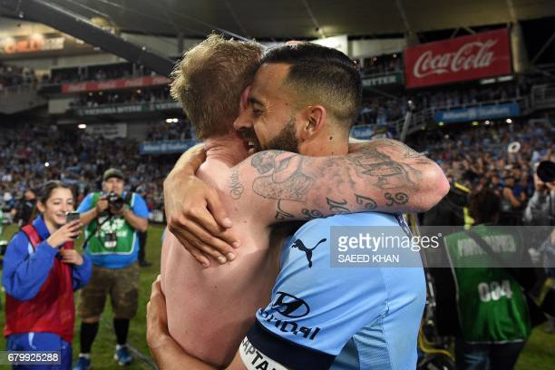 Sydney FC's captain Alex Brosque hugs teammate David Carney as they celebrate their victory in the 2017 ALeague Grand Final football match against...