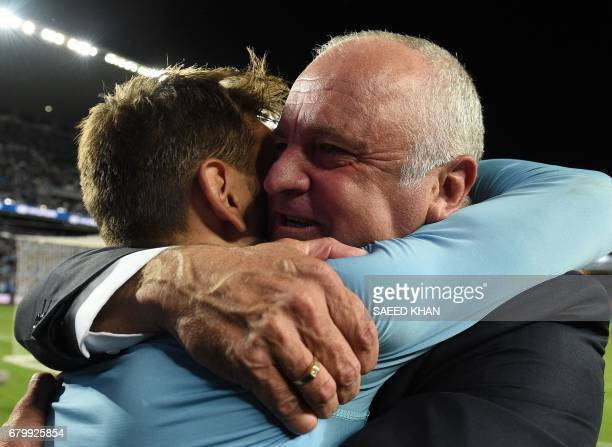 Sydney FC's coach Graham Arnold hugs player Milos Ninkovic after they won the 2017 ALeague Grand Final football match against Melbourne Victory at...