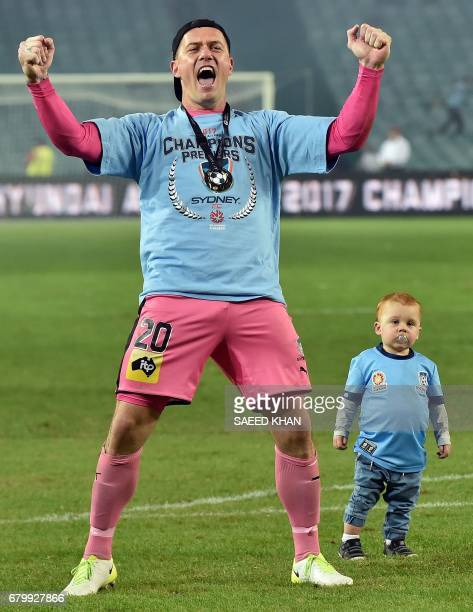 Sydney FC's goalkeeper Daniel Vukovic celebrates his team's victory in the 2017 ALeague Grand Final football match against Melbourne Victory at...
