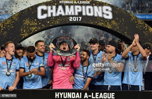 Sydney FC's goalkeeper Daniel Vukovic celebrates with his teammates after winning the 2017 ALeague Grand Final football match against Melbourne...