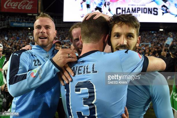 Sydney FC's Milos Ninkovic hugs teammates as they celebrate winning the 2017 ALeague Grand Final football match against Melbourne Victory at Allianz...