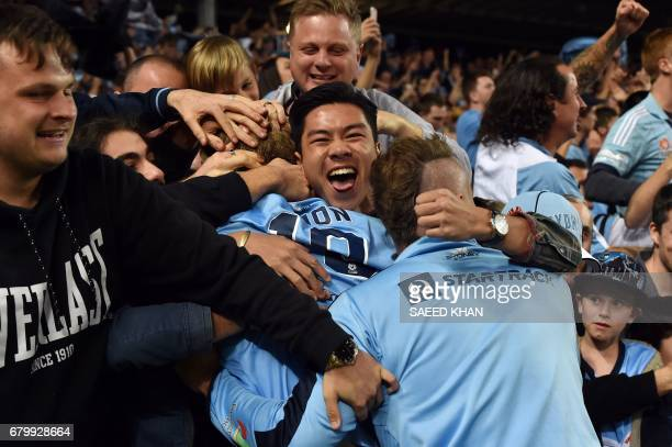 Sydney FC's players celebrate their victory with fans after the 2017 ALeague Grand Final football match against Melbourne Victory at Allianz Stadium...