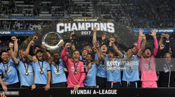 Sydney FC's team celebrates their victory in the 2017 ALeague Grand Final football match against Melbourne Victory at Allianz Stadium in Sydney on...