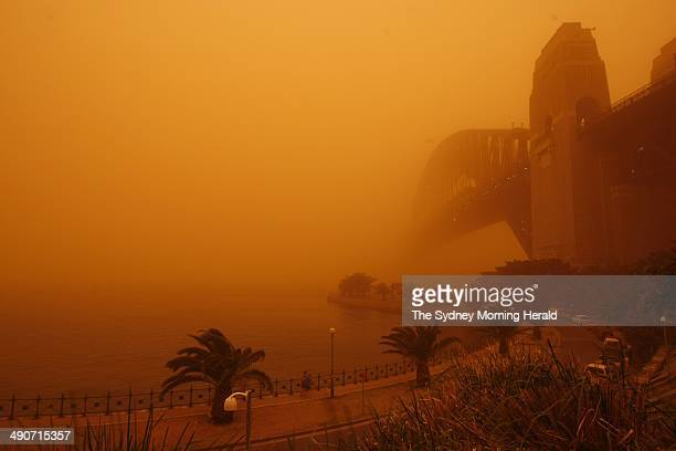 Sydney Harbour Bridge at 6am as the city and surrounding parts of NSW are covered in a shroud of dust