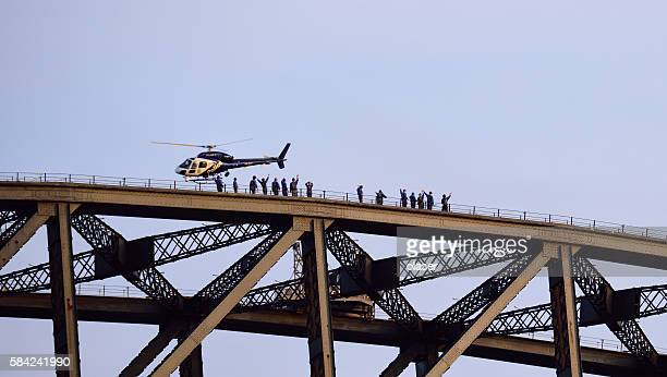 Sydney Harbour Bridge, people walking on top
