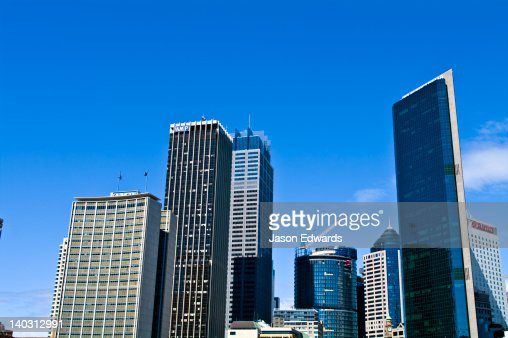 On a city skyline office towers and hotels rise into a blue sky. : Stock Photo