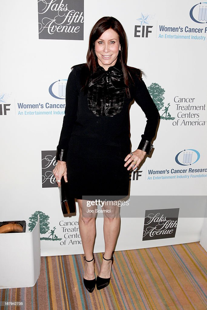 """Sydney Holland attends EIF Women's Cancer Research Fund's 16th Annual """"An Unforgettable Evening"""" presented by Saks Fifth Avenue at the Beverly Wilshire Four Seasons Hotel on May 2, 2013 in Beverly Hills, California."""