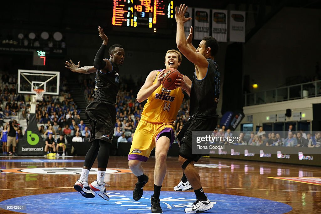 Sydney King Tommy Garlepp (L) goes for a shot defended by Breakers player Mika Vukona (R) during the round three NBL match between the New Zealand Breakers and the Sydney Kings at North Shore Events Centre on October 21, 2015 in Auckland, New Zealand.