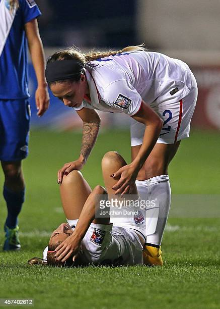 Sydney Leroux of the United States checks on Alex Morgan after a collision during a match against Guatemala during the 2014 CONCACAF Women's...