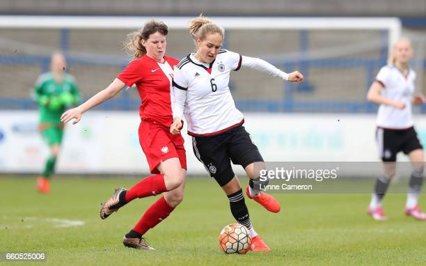 Sydney Lohmann of Germany and Adriana Achcinska of Poland during the UEFA U17 Women's Championship Qualifier match between Germany and Poland at New...