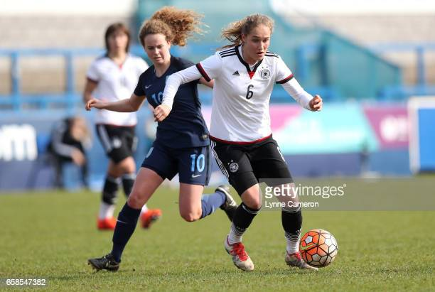 Sydney Lohmann of Germany and Emily Syme of England during the England v Germany U17 Girl's Elite Round match on March 27 2017 in Telford England