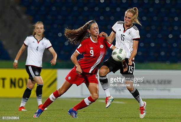 Sydney Lohmann of Germany b attles for the ball with Jordyn Huitema of Canada during the FIFA U17 Women's World Cup Jordan Group B match between...