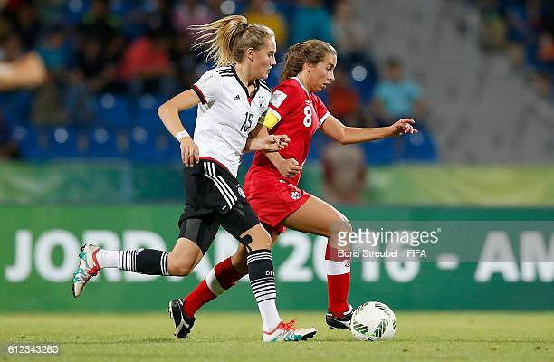 Sydney Lohmann of Germany challenges Sarah Stratigakis of Canada during the FIFA U17 Women's World Cup Jordan Group B match between Germany and...