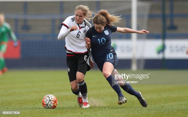 Sydney Lohmann of Germany hold off Emily Syme of England during the England v Germany U17 Girl's Elite Round match on March 27 2017 in Telford England