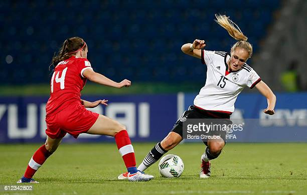 Sydney Lohmann of Germany is challenged by Caitlin Shaw of Canada during the FIFA U17 Women's World Cup Jordan Group B match between Germany and...