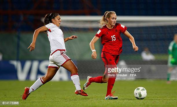 Sydney Lohmann of Germany is challenged by Paula Fernandez of Spain during the FIFA U17 Women's World Cup Quarter Final match between Germany and...
