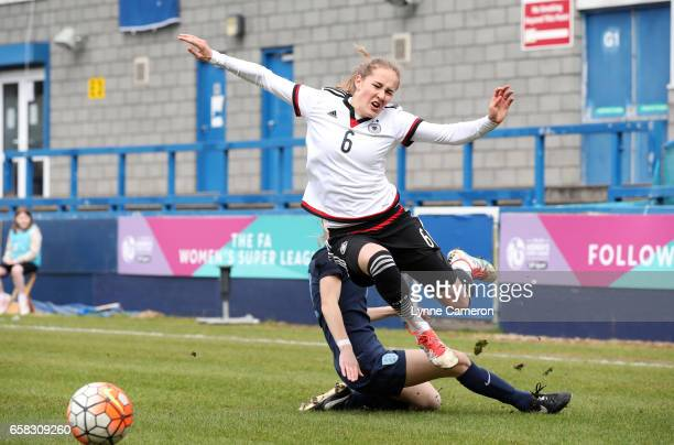 Sydney Lohmann of Germany is tackled by Grace Neville of England during the England v Germany U17 Girl's Elite Round match on March 27 2017 in...