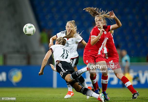 Sydney Lohmann of Germany jumps for a header with Emma Regan of Canada during the FIFA U17 Women's World Cup Jordan Group B match between Germany and...