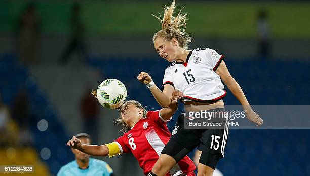 Sydney Lohmann of Germany jumps for a header with Sarah Stratigakis of Canada during the FIFA U17 Women's World Cup Jordan Group B match between...