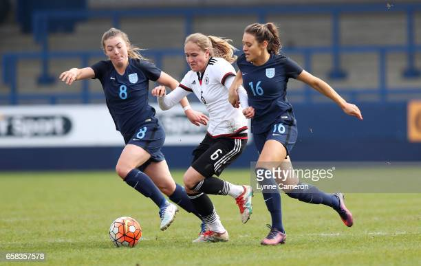 Sydney Lohmann of Germany plays the ball between Mirial Taylor of England and Ella Rutherford of England during the England v Germany U17 Girl's...