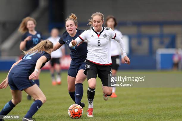 Sydney Lohmann of Germany tackled by Aimee Palmer of England and Grace Neville of England during the England v Germany U17 Girl's Elite Round match...