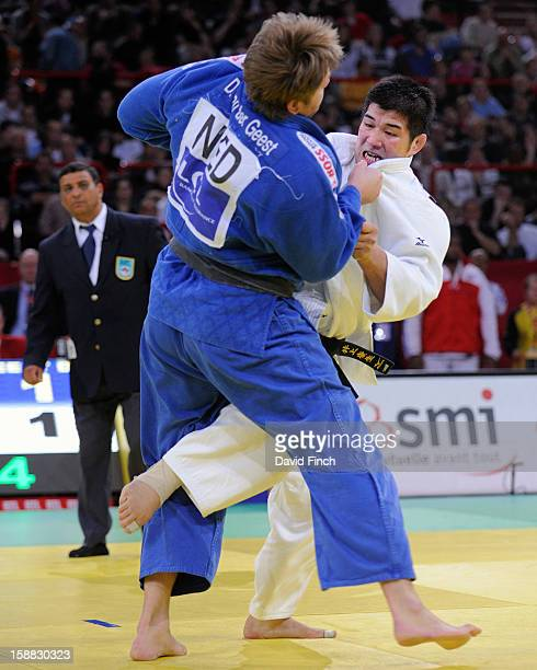 Sydney Olympic champion Kosei Inoue of Japan determinedly attacks former World champion Dennis Van der Geest of Holland to throw him for ippon during...