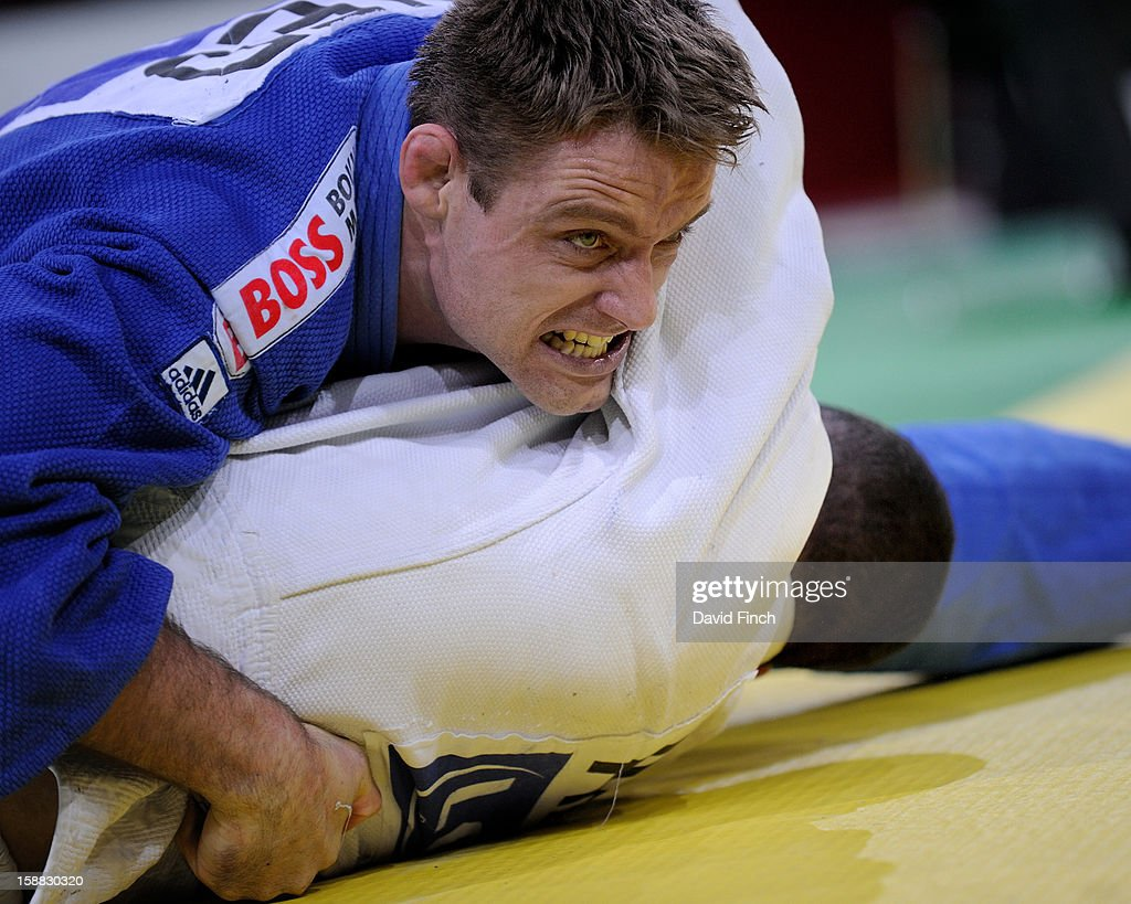 Sydney Olympic Champion, Mark Huizinga of Holland (blue), holds Amar Benikhlef of Algeria for ippon (10 points) during the u90kgs eliminations at the Paris Tournament on day 2, Sunday, February 10, 2008 at the Palais Omnisports de Paris Bercy Sports Arena, Bercy, Paris, France.