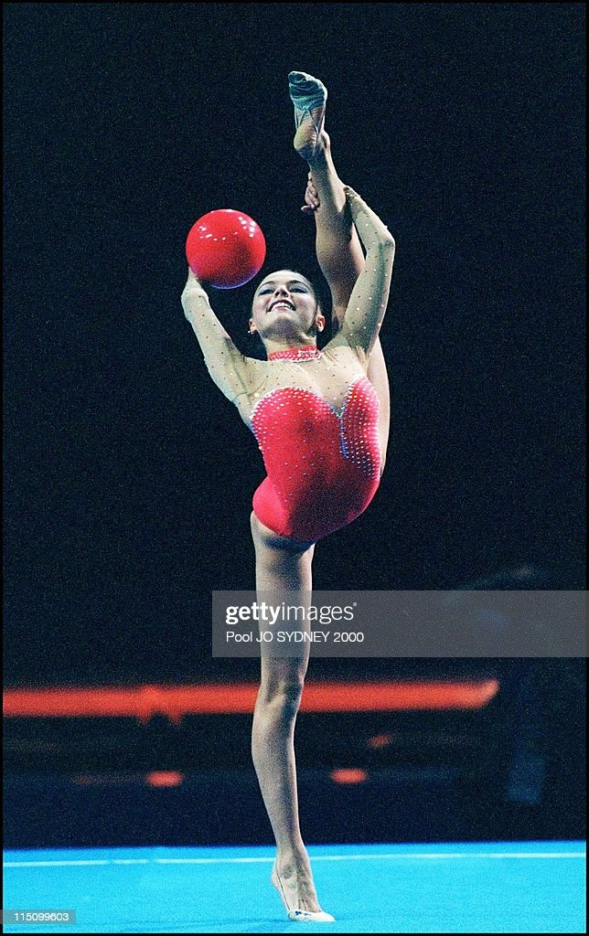 Gymnastics in Sydney, Australia on September 26, 2000 - Rythmic gymnastic: <a gi-track='captionPersonalityLinkClicked' href=/galleries/search?phrase=Alina+Kabaeva&family=editorial&specificpeople=633246 ng-click='$event.stopPropagation()'>Alina Kabaeva</a>.