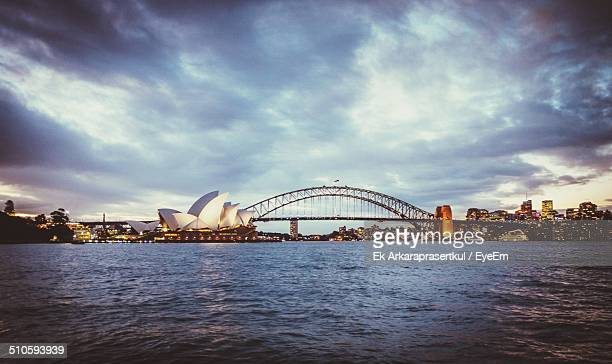 Sydney Opera House and Harbor Bridge against dramatic sky