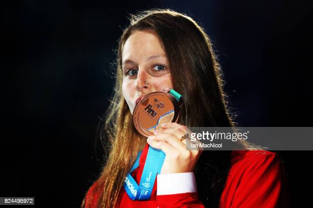 Sydney Pickrem of Canada poses with her bronze medal from the Women's 400m IM final during day seventeen of the FINA World Championships at the Duna...