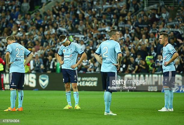 Sydney players are dejected after they were defeated by the Victory the 2015 ALeague Grand Final match between the Melbourne Victory and Sydney FC at...