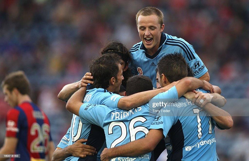 Sydney players celebrate a goal during during the round 19 A-League match between the Newcastle Jets and Sydney FC at Hunter Stadium on February 2, 2013 in Newcastle, Australia.