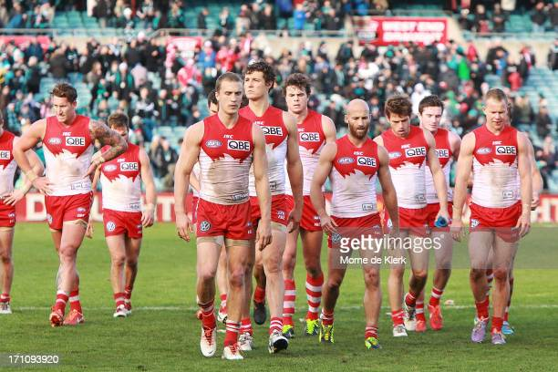 Sydney players come from the field after the round 13 AFL match between Port Adelaide Power and the Sydney Swans at AAMI Stadium on June 22 2013 in...