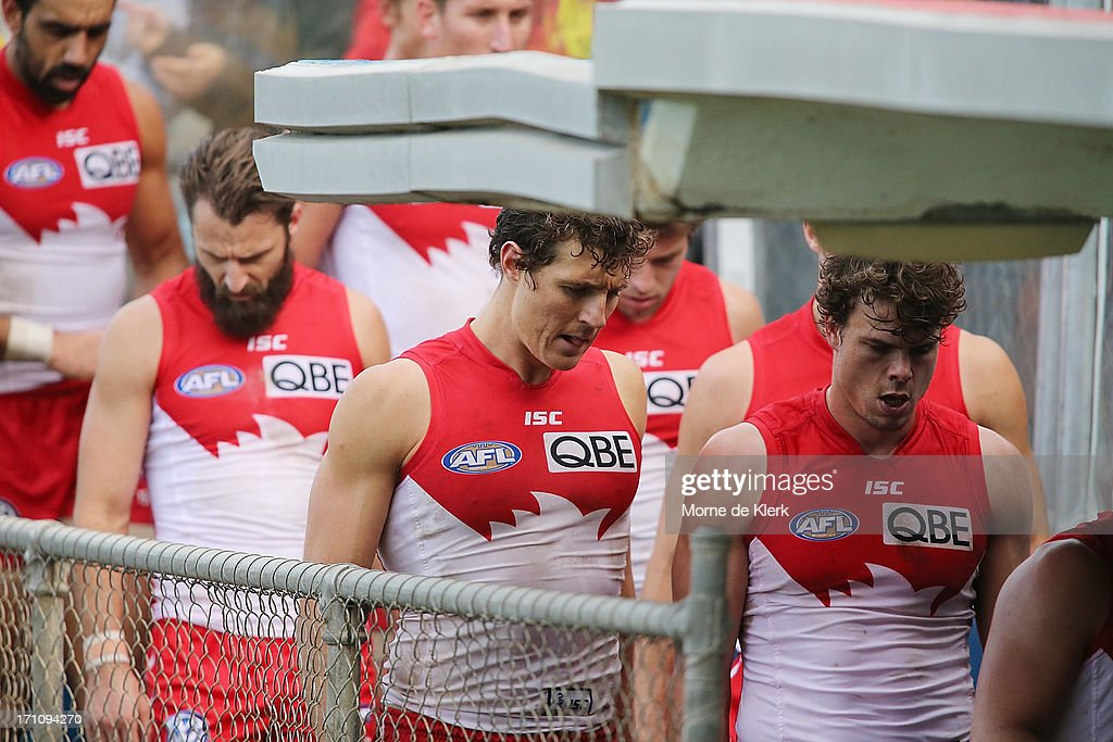 Sydney players including <a gi-track='captionPersonalityLinkClicked' href=/galleries/search?phrase=Kurt+Tippett&family=editorial&specificpeople=779177 ng-click='$event.stopPropagation()'>Kurt Tippett</a> leave the field at half time during the round 13 AFL match between Port Adelaide Power and the Sydney Swans at AAMI Stadium on June 22, 2013 in Adelaide, Australia.