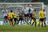 Sydney players jump to block a penalty kick by Carlos Hernandez of the Phoenix during the round 26 ALeague match between Sydney FC and the Wellington...