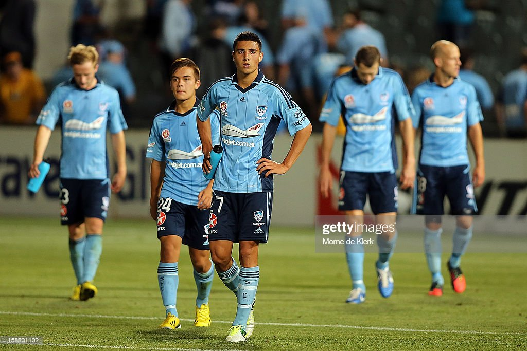 Sydney players leave the field after the round 14 A-League match between Adelaide United and Sydney FC at Hindmarsh Stadium on December 31, 2012 in Adelaide, Australia.