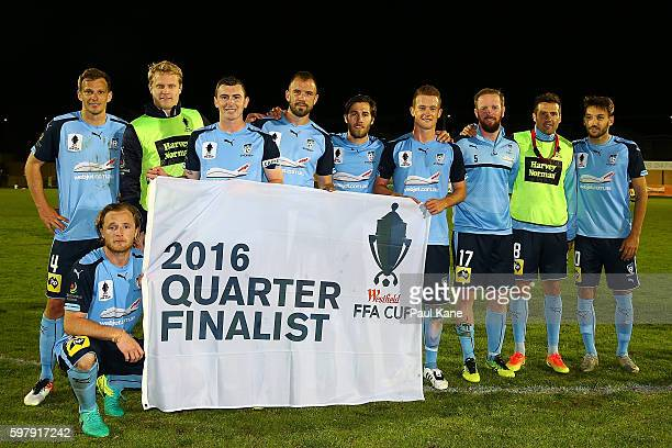 Sydney players pose with Quarter Finalist banner after winning the round 16 FFA Cup match between Perth Glory and Sydney FC at Dorrien Gardens on...