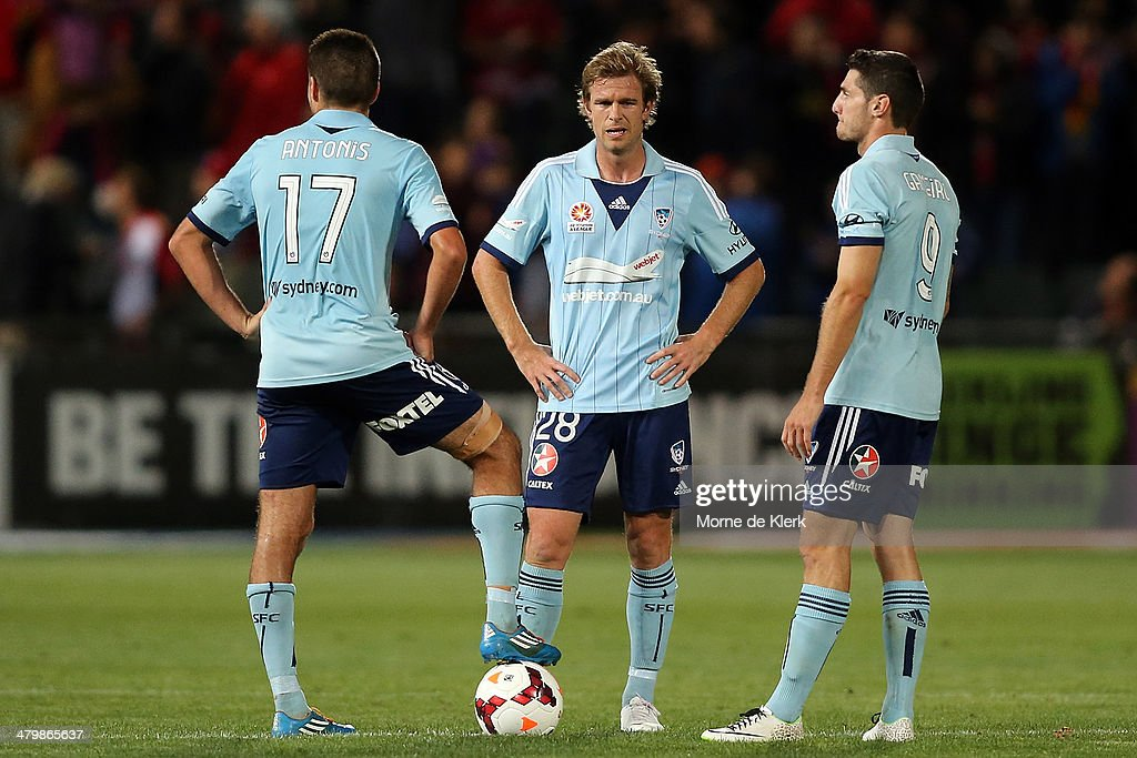 Sydney players wait to restart after Adelaide scored a goal during the round 24 A-League match between Adelaide United and Sydney FC at Coopers Stadium on March 21, 2014 in Adelaide, Australia.