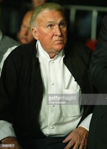 Sydney radio star John Laws watches on during the WBA Super middleweight world title fight between Anthony Mundine and Manny Siaca held at the Sydney...