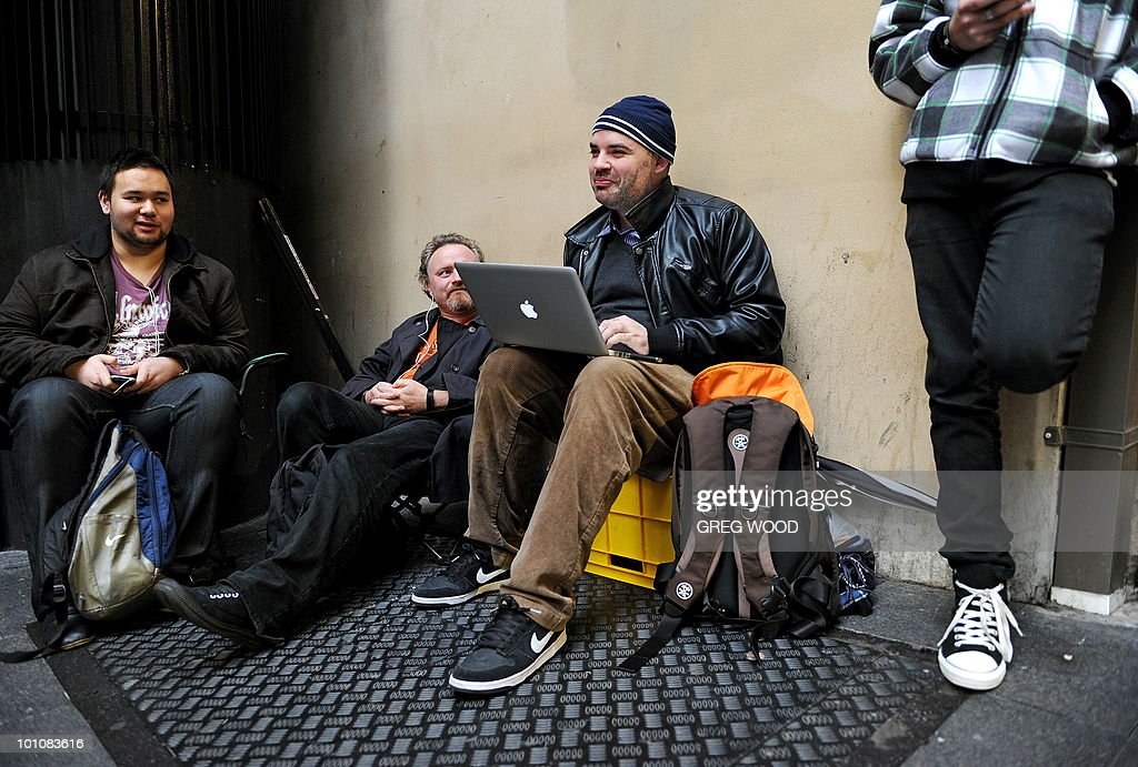 Sydney residents wait in line outside Apple's flagship store in Sydney on May 28, 2010 just prior to the much-hyped iPad going on sale. The iPad -- a buttonless tablet computer targeted at the leisure market -- is also going on sale in Japan, Britain, Canada, France, Germany, Italy, Japan, Spain and Switzerland on May 28 as part of a staggered global roll-out. AFP PHOTO / Greg WOOD