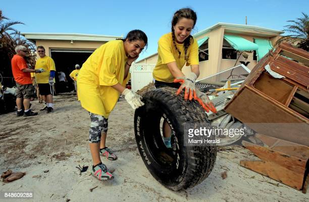 Sydney Rojers and Raquel Lopez left to right volunteers from the Church of Jesus Christ of LatterDay Saints clear debris from a Monroe County...