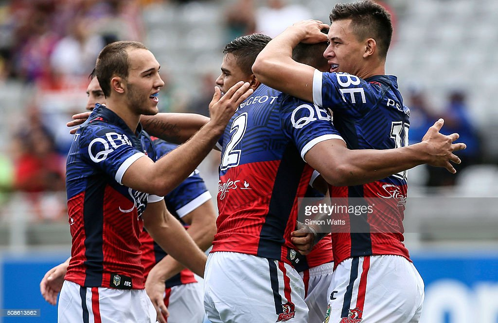Sydney Roosters players celebrate a try during the 2016 Auckland Nines match between the Sydney Roosters and the South Sydney Rabbitohs at Eden Park on February 6, 2016 in Auckland, New Zealand.