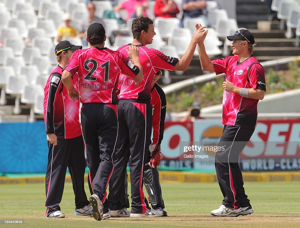 Sydney Sixers players celebrate during the Karbonn Smart CLT20 match between bizbub Highveld Lions (South Africa) and Sydney Sixers (Australia) at Sahara Park Newlands on October 18, 2012 in Cape Town, South Africa.