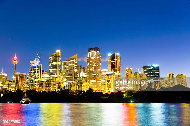 Sydney skyline at night with colourful lights, copy space